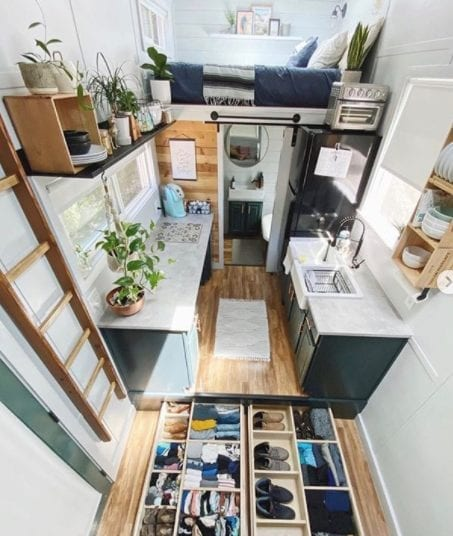 A tiny home featuring living, dining, and storage areas.