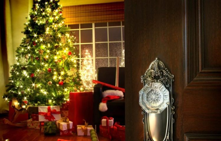 Door opening to Christmas tree with gifts